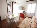 soggiorno appartamento trilocale con giardino comune residence acquaverde bibione